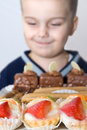 Boy happy to eat cakes Stock Image