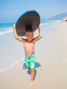 Boy has fun with the surfboard little surfer runing near ocean Stock Photos