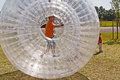Boy has a lot of fun in the zorbing ball child Stock Photos