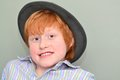 Boy in a hat portrait of red haired grey Royalty Free Stock Photos