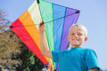 Boy having fun with a kite blonde in the park Royalty Free Stock Photos