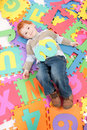 Boy having fun learning kids alphabet letters Royalty Free Stock Photo