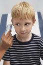 Boy Having Temperature Taken With Ear Thermometer Royalty Free Stock Photo
