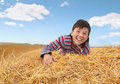 The boy and a haystack Royalty Free Stock Photos