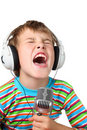 Boy in headphone with microphone in hands sings Stock Photo