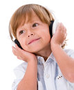Boy with headphones happy wearing big isolated over white background Royalty Free Stock Image