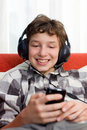 Boy with Headphones Listening to mp3 player Stock Image