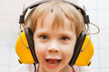 Boy with headphones little listening to music Royalty Free Stock Photos
