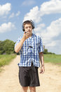 Boy with headphones and mic on rural road in summer Royalty Free Stock Images