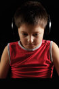 Boy in headphones sitting at laptop darkness Stock Photos