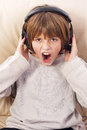 Boy headphones teenager enjoys music Royalty Free Stock Image
