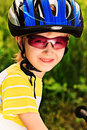 Boy in helmet portrait of a cute with a bicycle outdoors Stock Photography