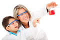 Boy helping mum with an experiment Royalty Free Stock Image