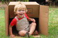 A boy and his box cute happy toddler playing with large cardboard Stock Photography