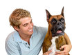 Boy and his dog a young man having fun with boxer Stock Photography