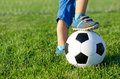 Boy with his foot on a soccer ball Royalty Free Stock Photo