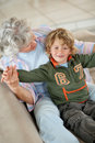 Boy and his grandmother having fun Stock Photography