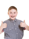 Boy with his hands rise up as a sign of everything cool Stock Image