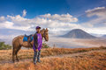 A boy and his horse at Bromo Tengger Semeru National Park Royalty Free Stock Photo