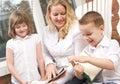 Boy his mother reads sister to young Στοκ φωτογραφία με δικαίωμα ελεύθερης χρήσης