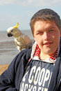 Boy with his pet parrot Royalty Free Stock Photo