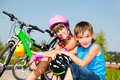 Boy and his sister in protective cycling helmets Royalty Free Stock Photography