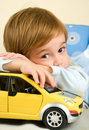 Boy with his toy car Stock Photo