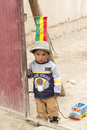 Boy with his toy car uyuni bolivia january a little plays in a desert town january in uyuni bolivia Royalty Free Stock Photos