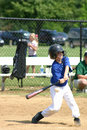 Boy Hitting Ball Royalty Free Stock Photo