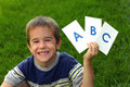Boy Holding ABC'S Stock Photos
