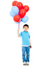 Boy holding balloons Stock Images