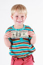 Boy holding a bank note smiling in his hands Stock Image