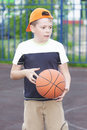 Boy holding basketball Stock Images