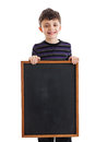 Boy holding blank chalkboard a year old elementary school a isolated on a white background Royalty Free Stock Photography