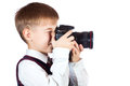 Boy is holding camera and taking a photo Stock Photo