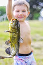 Boy holding catfish holds up large on a string Stock Photo