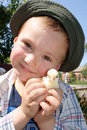 A boy holding a chick Royalty Free Stock Photos