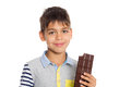 Boy holding a chocolate bar Royalty Free Stock Photo