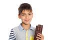 Boy holding a chocolate bar Royalty Free Stock Photo