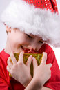 Boy holding a christmas gift Royalty Free Stock Photos