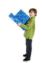 Boy holding christmas presents year old a stack of wrapped isolated on white background Stock Image