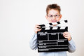 Boy holding clapper board little in hands Royalty Free Stock Photos