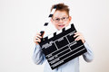 Boy holding clapper board little in hands Stock Photo