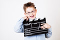 Boy holding clapper board little in hands Stock Photos