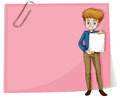 A boy holding an empty signage standing in front of an empty pap illustration paper on white background Royalty Free Stock Images