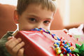 Boy holding gift. Royalty Free Stock Images