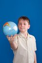 Boy holding a globe Stock Photos