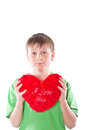 Boy holding a heart Royalty Free Stock Images