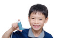 Boy holding inhaler and smiles young asian over white Royalty Free Stock Images
