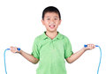 Boy holding a jump rope isolated on white background Royalty Free Stock Photo